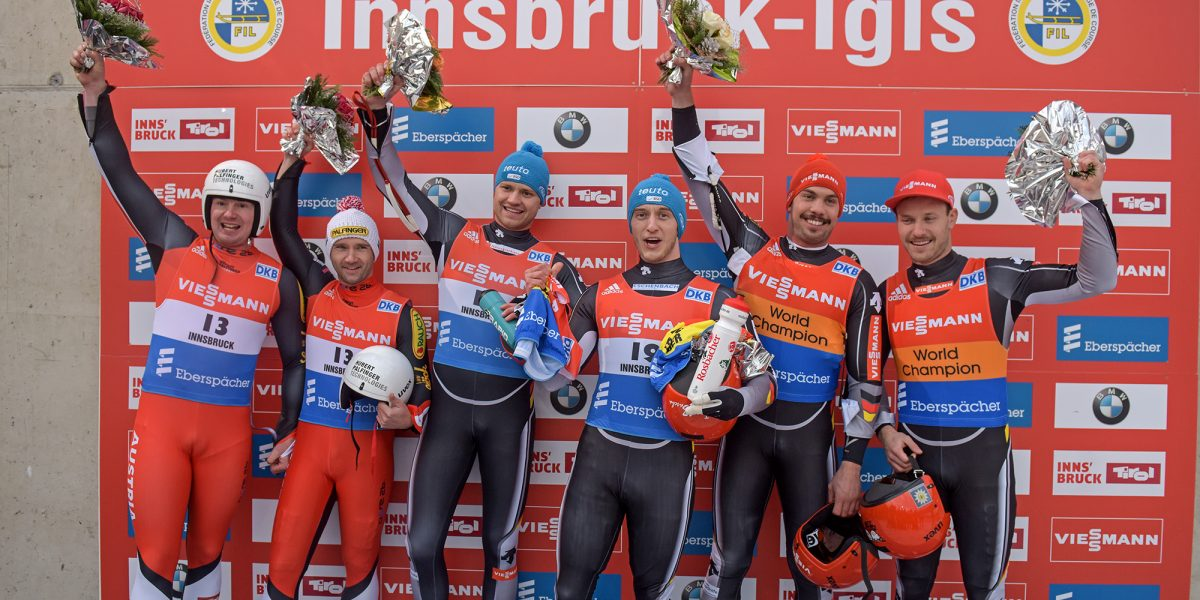 IGLS,AUSTRIA,28.NOV.15 - LUGE - FIL World Cup, artificial track, doubles, men, flower ceremony. Image shows Peter Penz and Georg Fischler (AUT), Toni Eggert and Sascha Benecken (GER) and Tobias Wendl and Tobias Arlt (GER). Photo: GEPA pictures/ Hans Osterauer