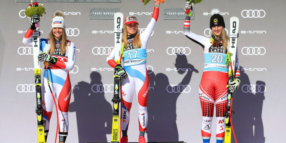 CRANS MONTANA,SWITZERLAND,22.FEB.20 - ALPINE SKIING - FIS World Cup, downhill, ladies. Image shows the rejoicing of Corinne Suter (SUI), Lara Gut Behrami (SUI) and Nina Ortlieb (AUT). Photo: GEPA pictures/ Mario Buehner